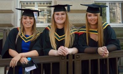 Three female students at their graduation