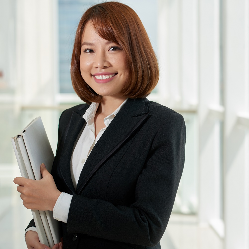 Female suited lawyer looking at the camera