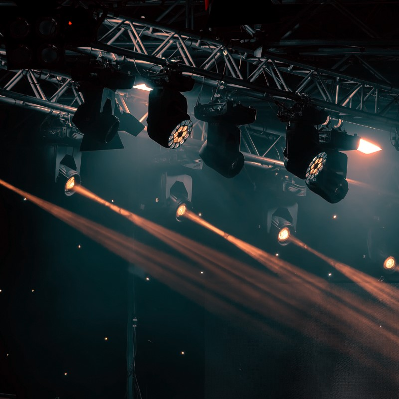 A lighting rig shining down on a stage