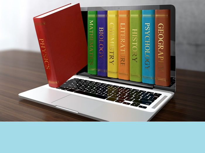 Decorative image; books and a laptop