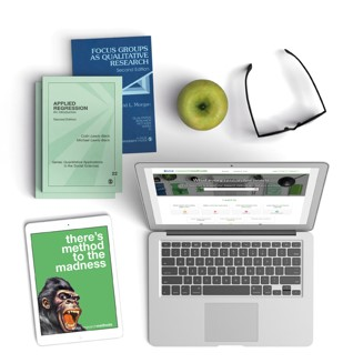 Picture of laptop and tablet showing Sage Research Methods database, together with books, spectacles, and an apple