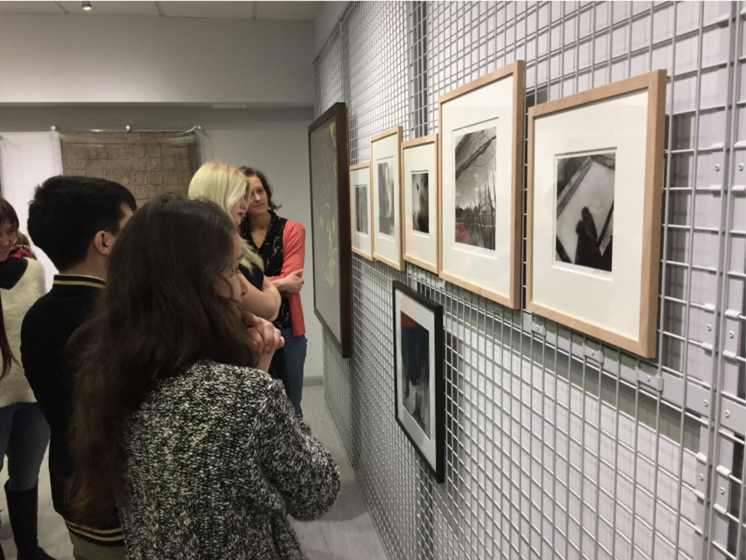 Students looking at artworks in ESCALA space