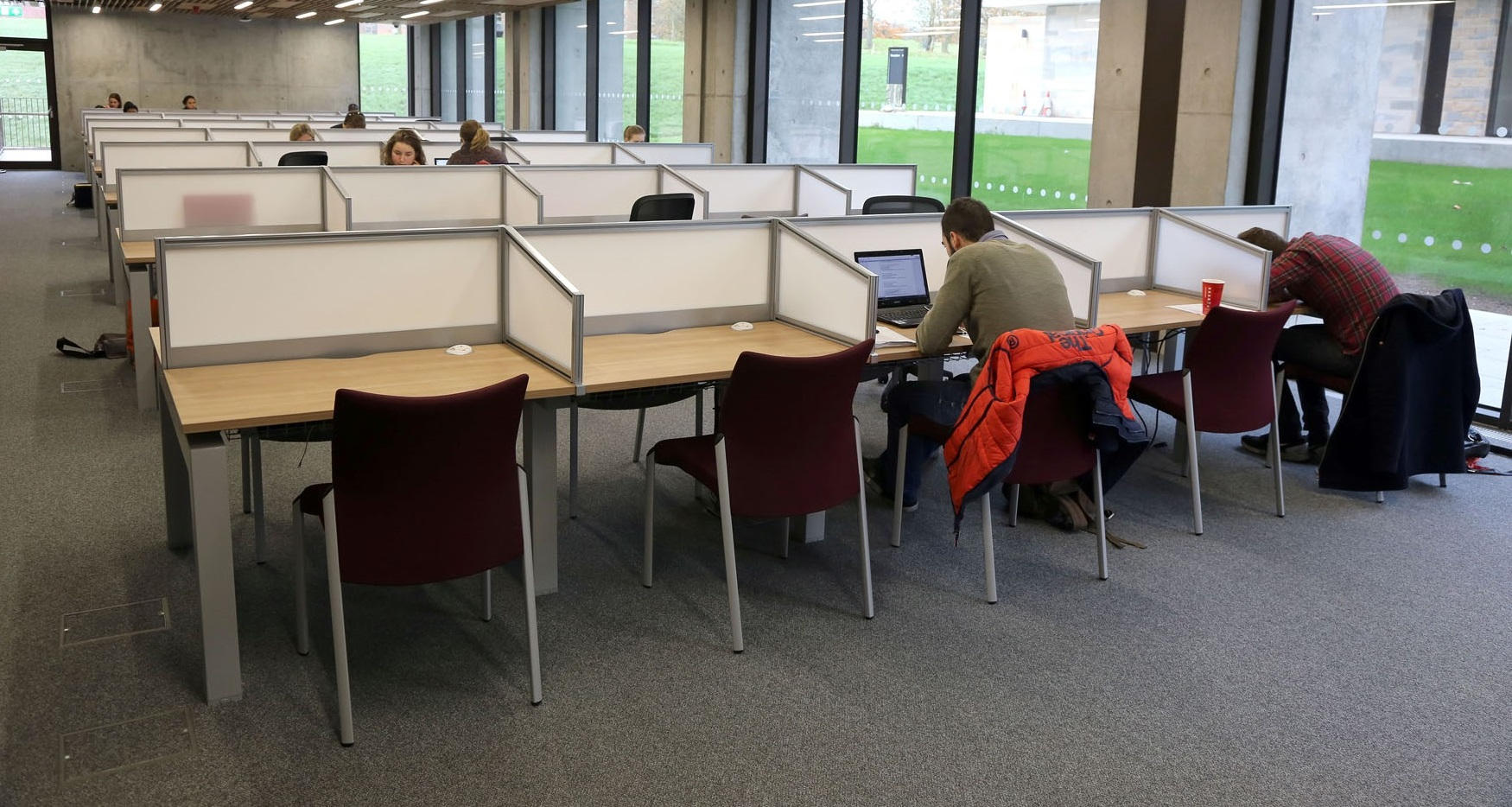 Students working in an open plan study space