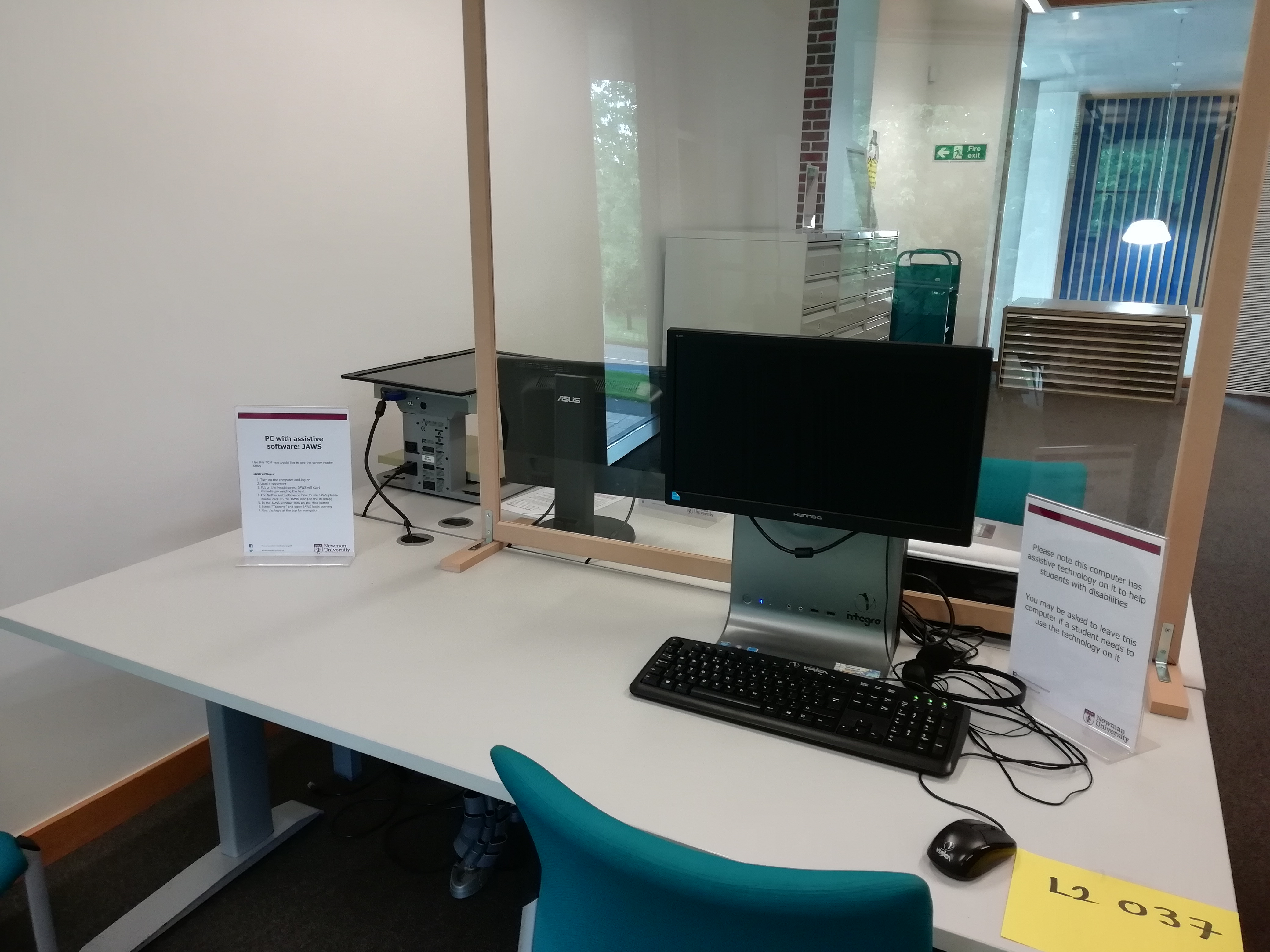 Example of individual study space with height-adjustable desk and computer